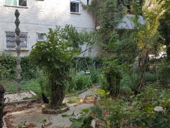 """Someone's attempt at """"beautifying"""" the garden of a commie-block"""